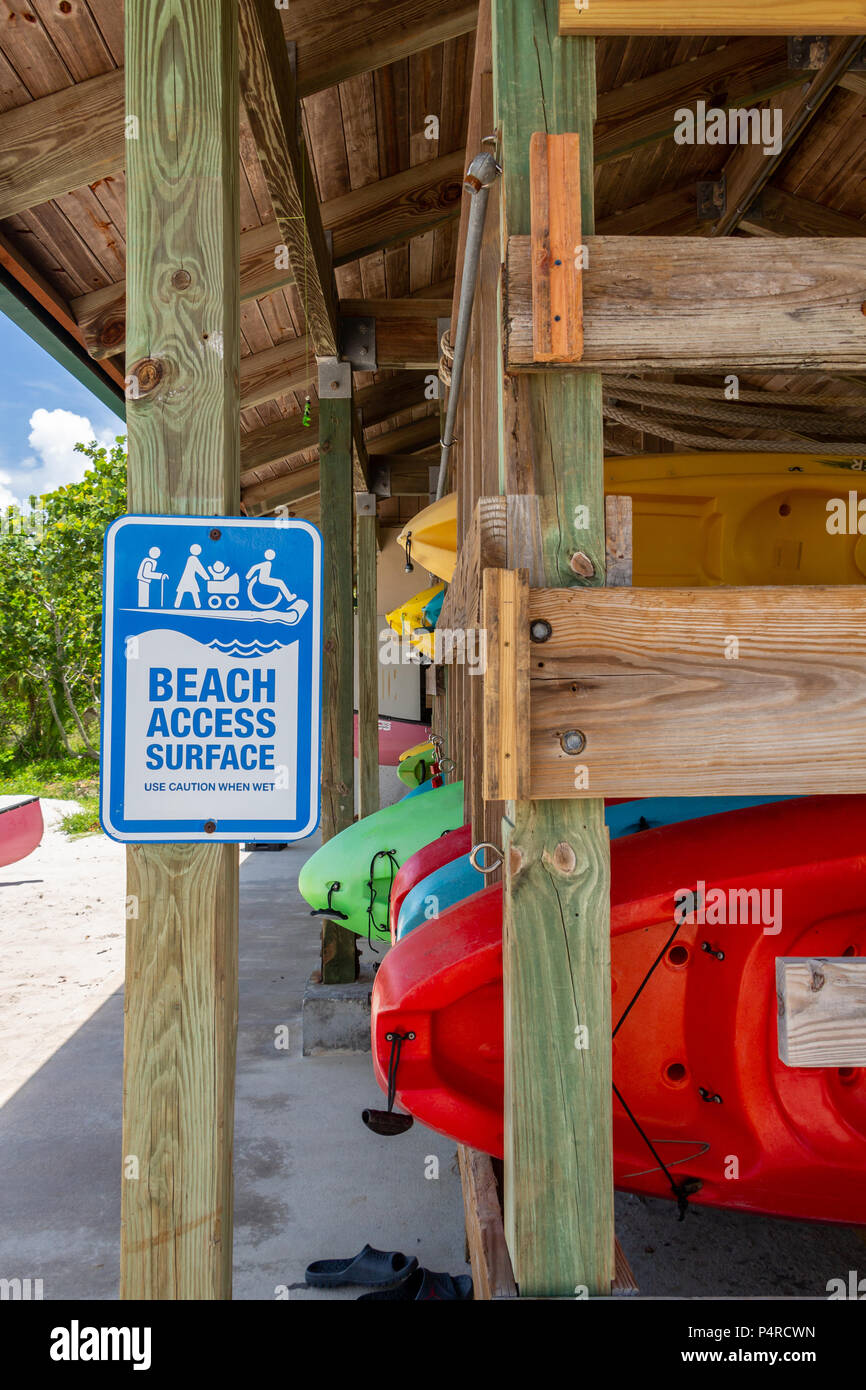 Kayaks for rent on wooden rack at marina with beach access sign - West Lake Park, Hollywood, Florida, USA Stock Photo