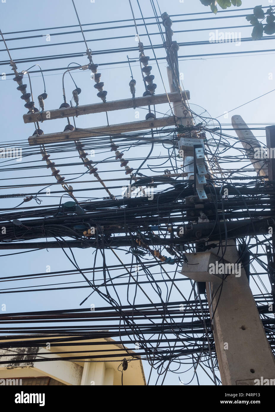 Low angle view of overhead electricity cables, Prachuap Khiri Khan Province, Hua Hin, Thailand, Asia. - Stock Image