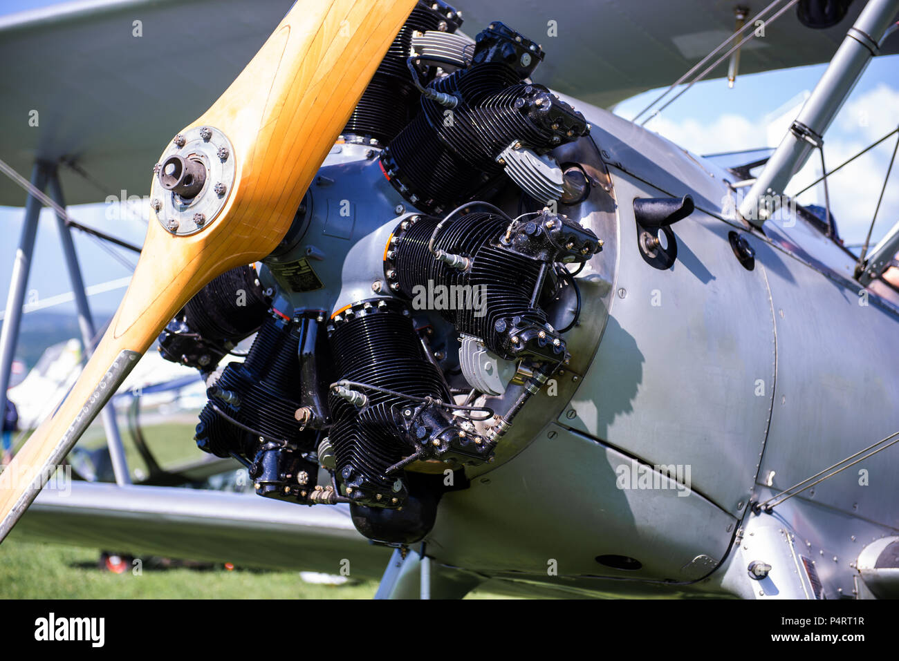Vintage aircraft with radial engine and wooden propeller, close up of nose section - Stock Image
