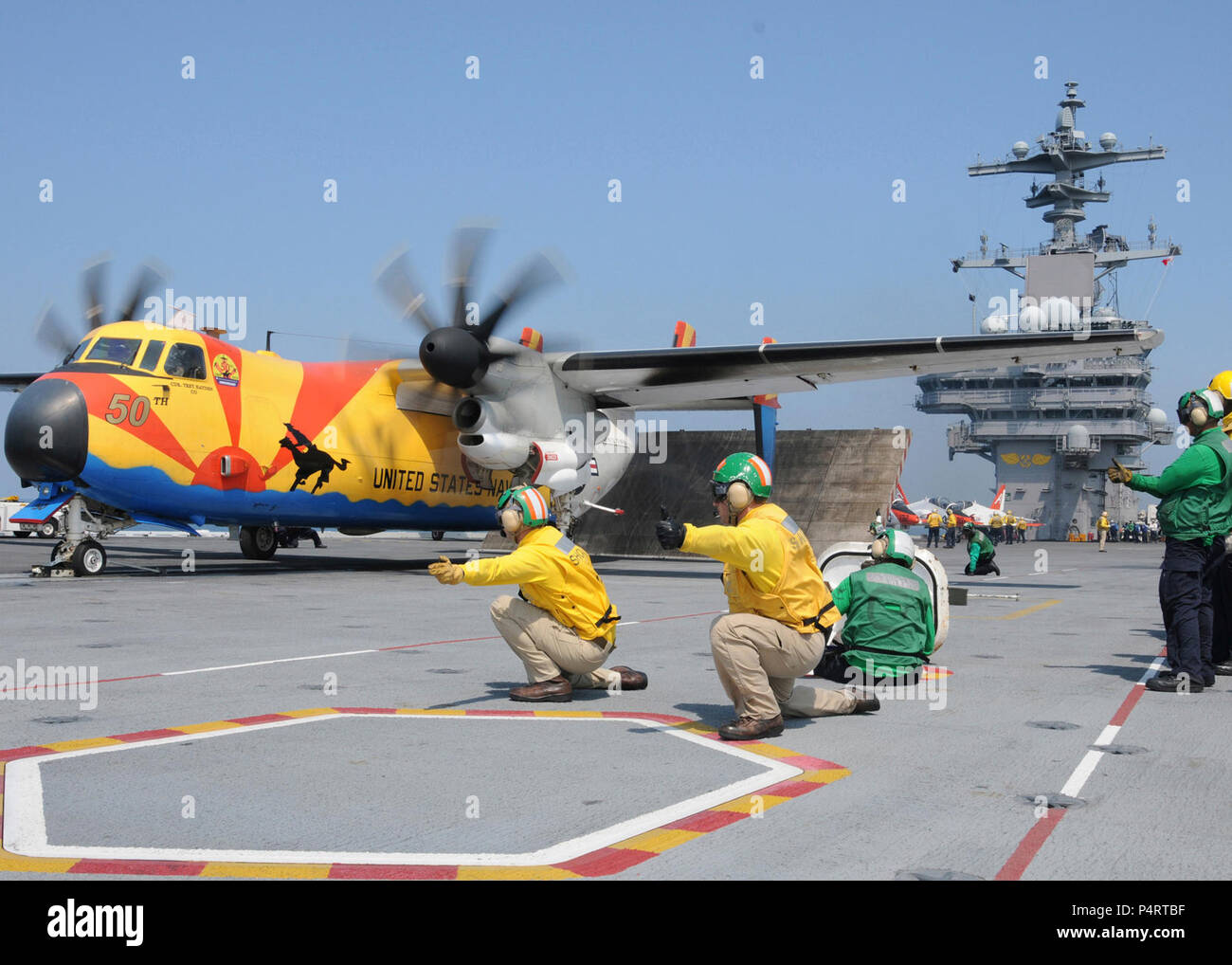 U.S. Navy shooters launch a C-2A Greyhound aircraft assigned to Fleet Logistics Support Squadron 40 from aboard the aircraft carrier USS George H.W. Bush (CVN 77) June 11, 2010, while conducting training operations in the Atlantic Ocean. (DoD Stock Photo