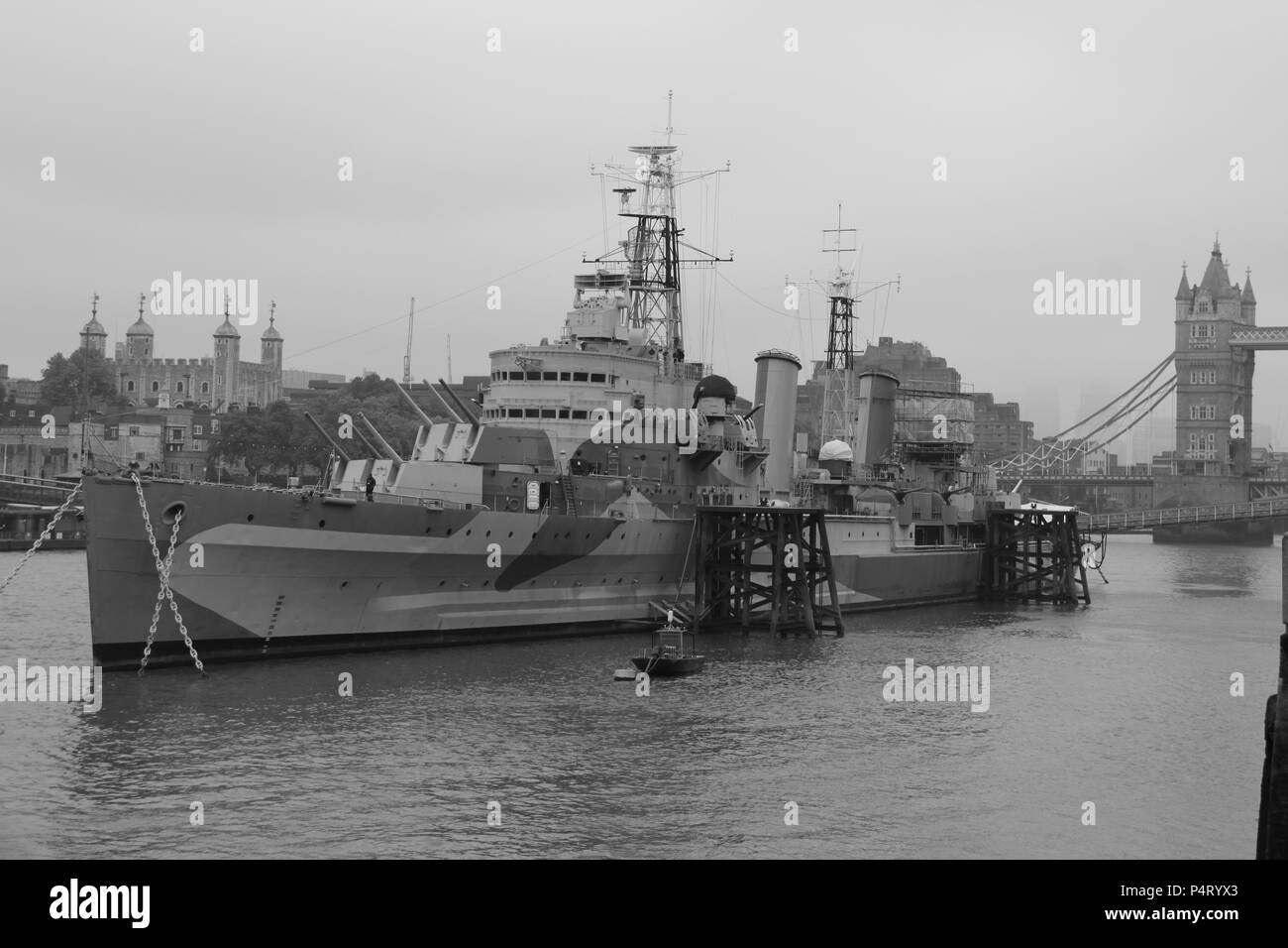 HMS Belfast is a Town-Class light cruiser that was built for the Royal Navy; now permanently moored as a museum on the River Thames, UK, PETER GRANT - Stock Image