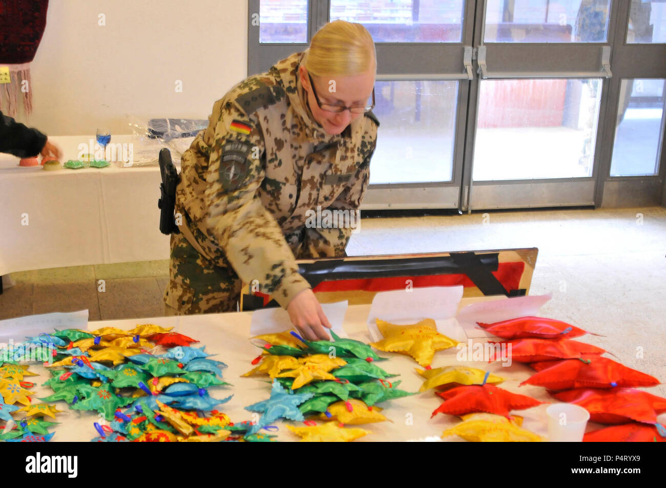 German Capt  Jennifer Ruge looks at the goods offered at the