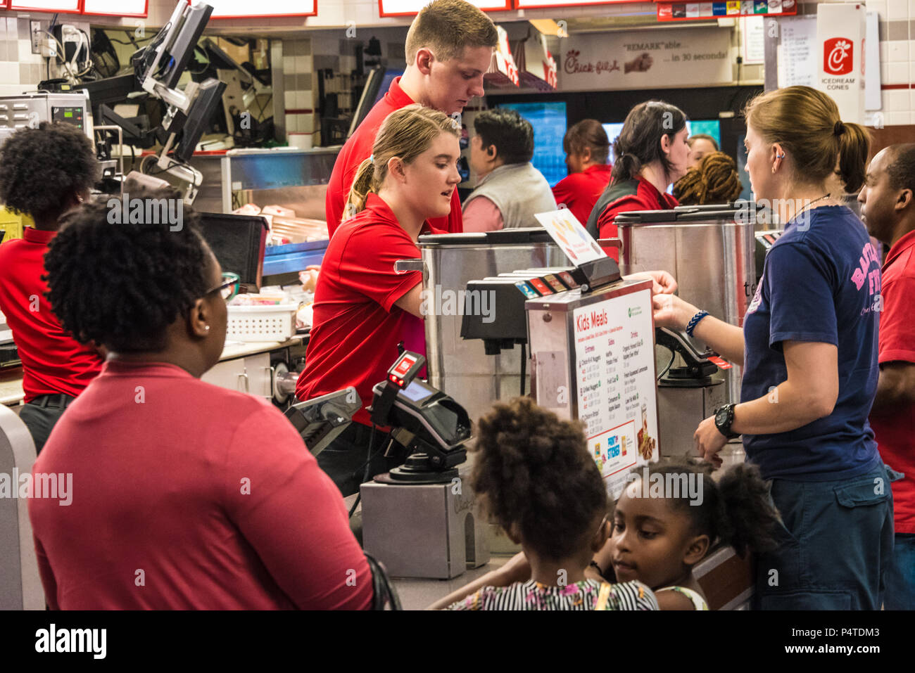 Customers ordering food at a busy Chick-fil-A restaurant in Olive Branch, Mississippi. (USA) - Stock Image