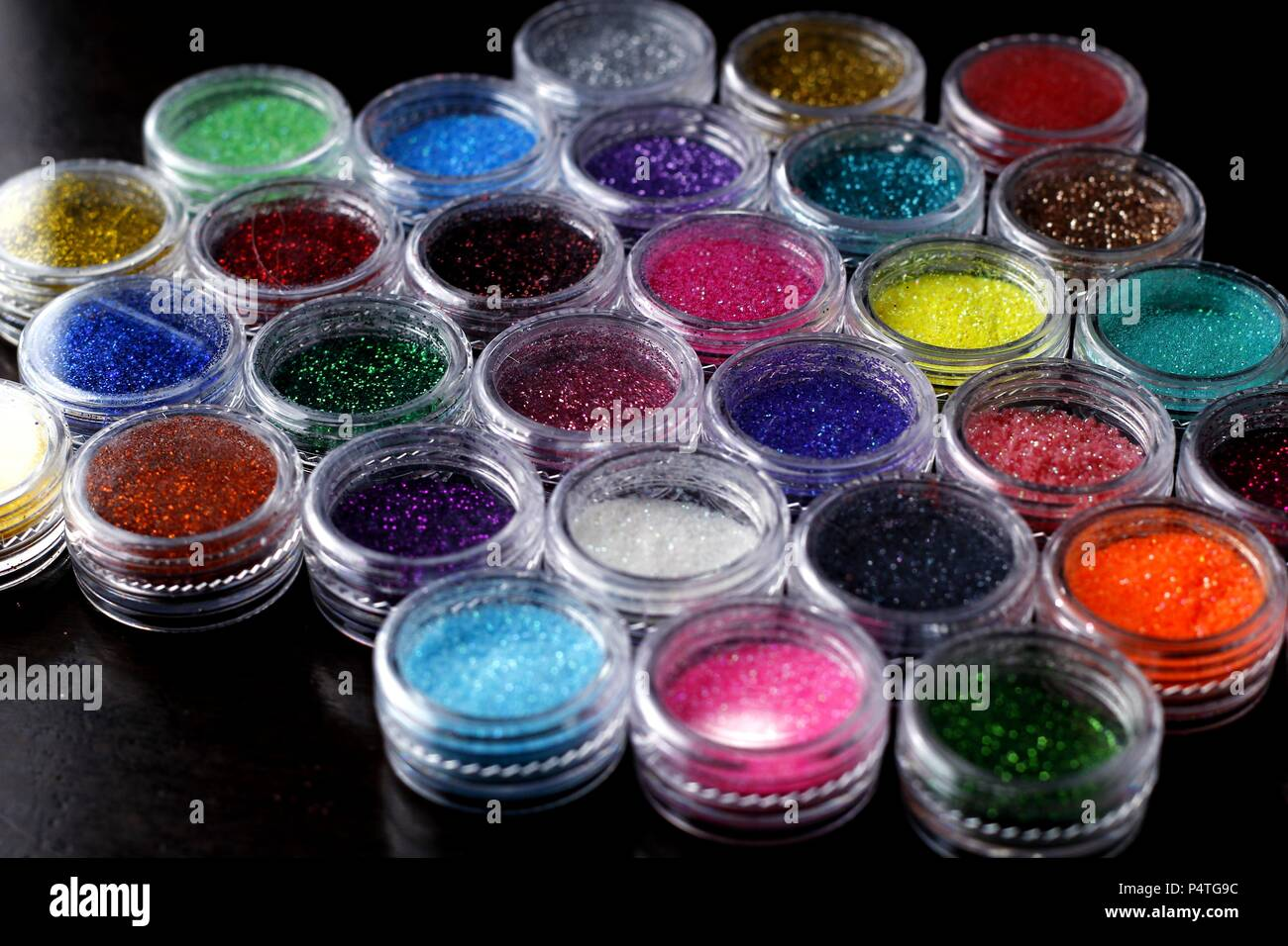 Photo of assorted colorful nail polish glitters - Stock Image