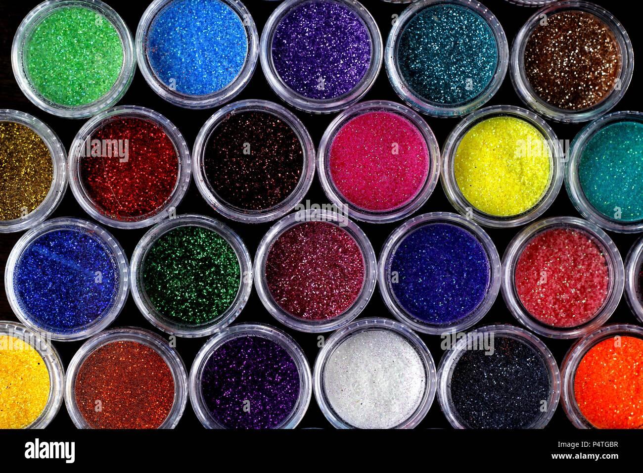 Photo of assorted colorful nail polish glitters Stock Photo