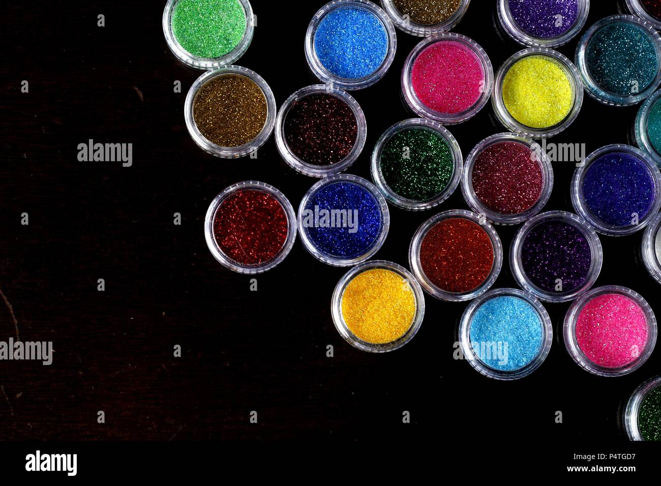 Photo of assorted colorful nail polish glitters Stock Photo