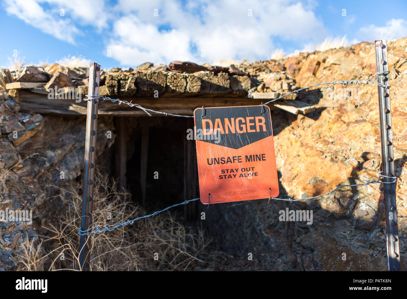 Entrance to a mining shaft barred with stay out sign - Stock Image