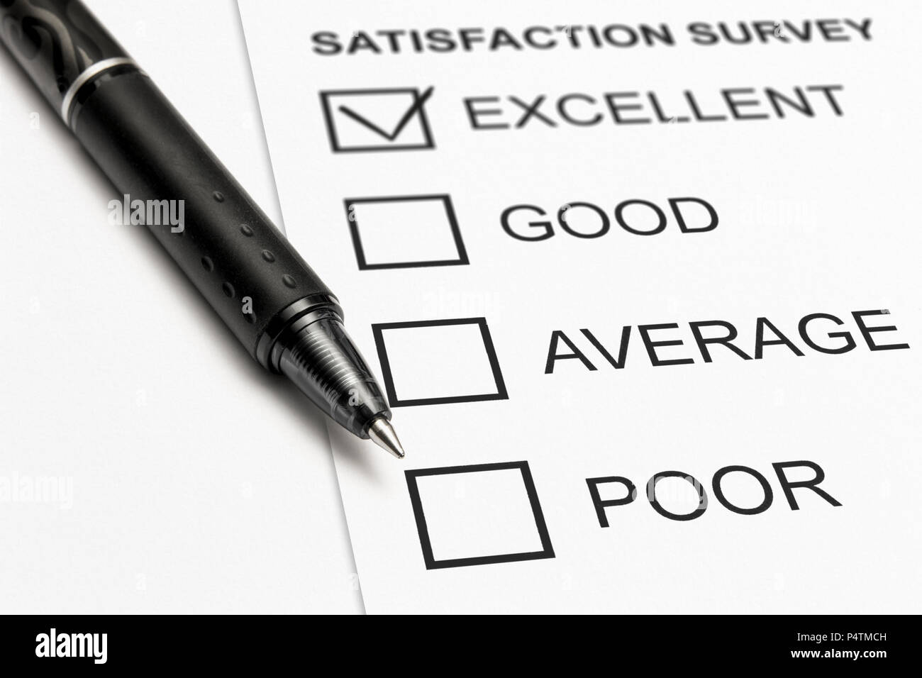 close up of a satisfaction survey with a check mark on excellent - Stock Image
