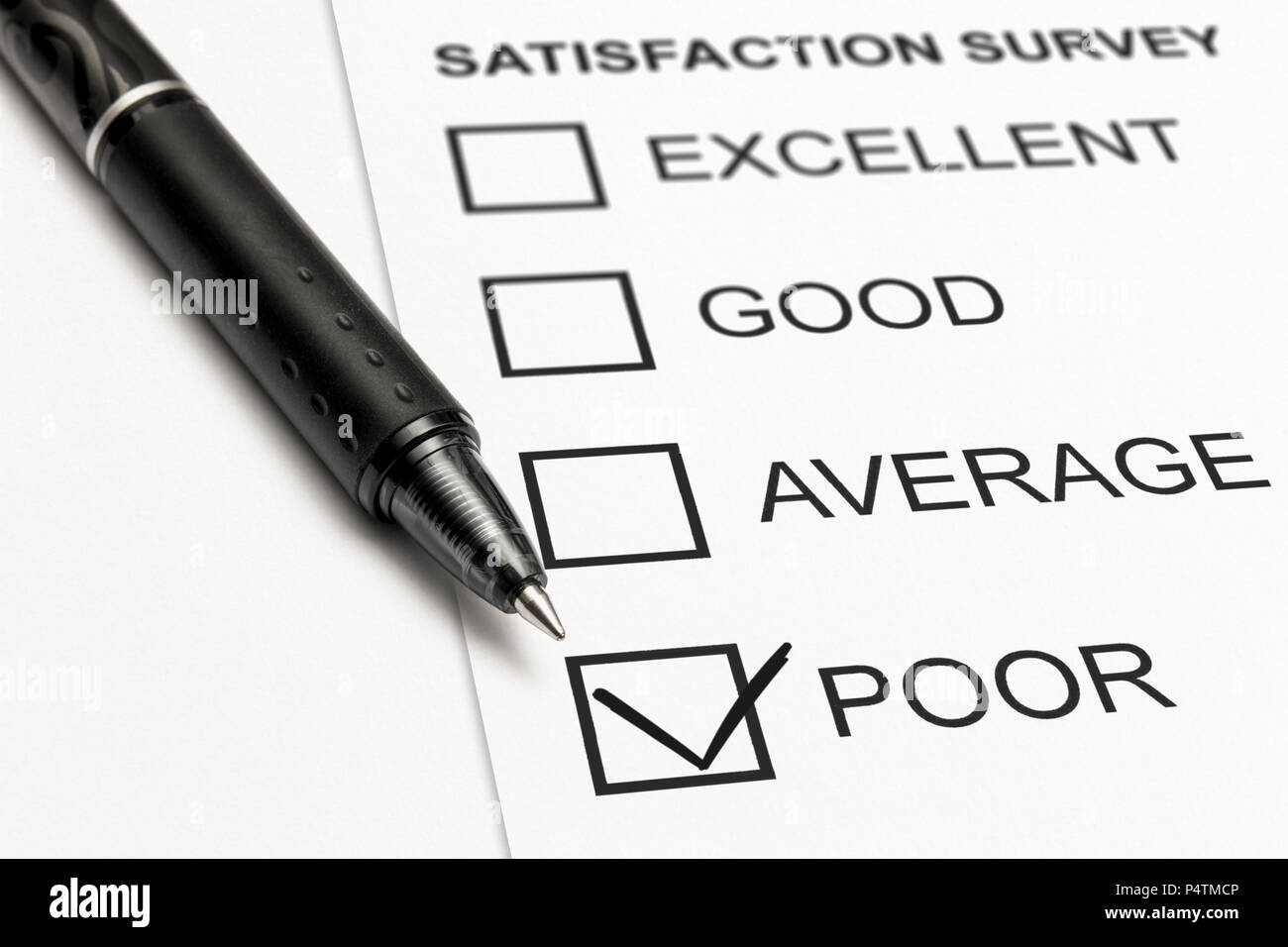 close up of a satisfaction survey with a check mark on poor - Stock Image