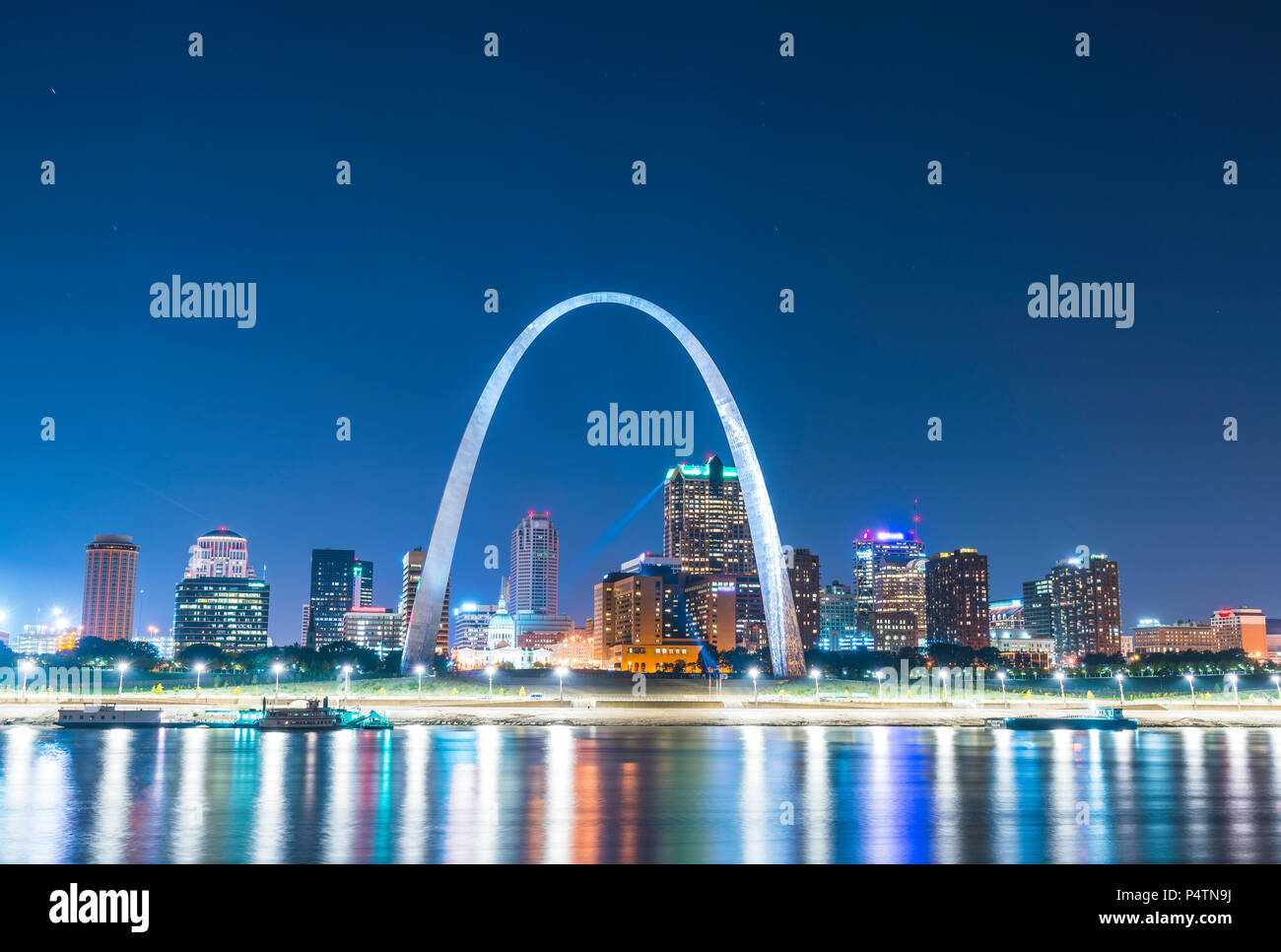st. louis skyscraper at night with reflection in river,st. louis,missouri,usa. - Stock Image