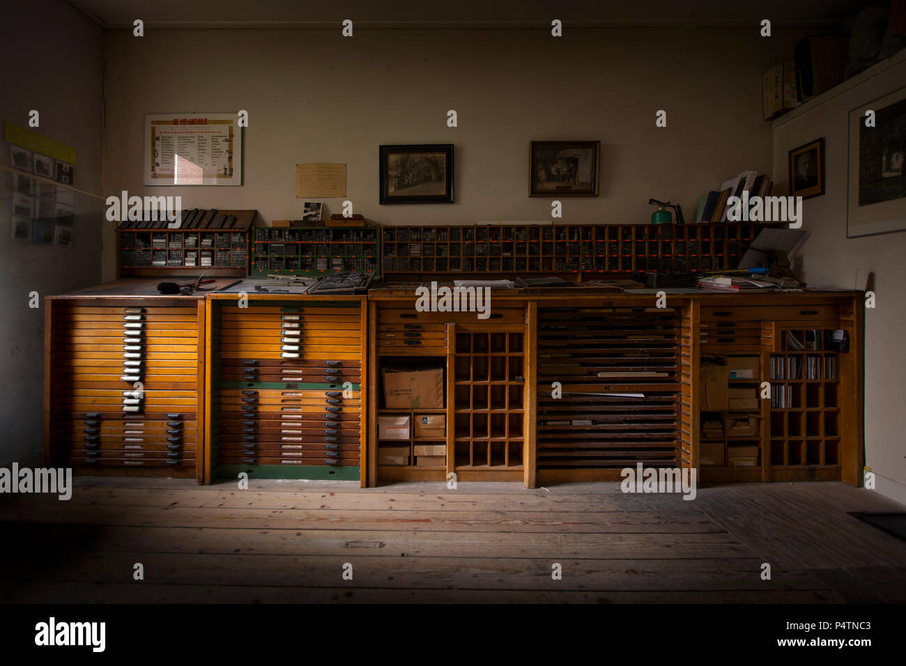 Type case in an old print office lit by one window - Stock Image