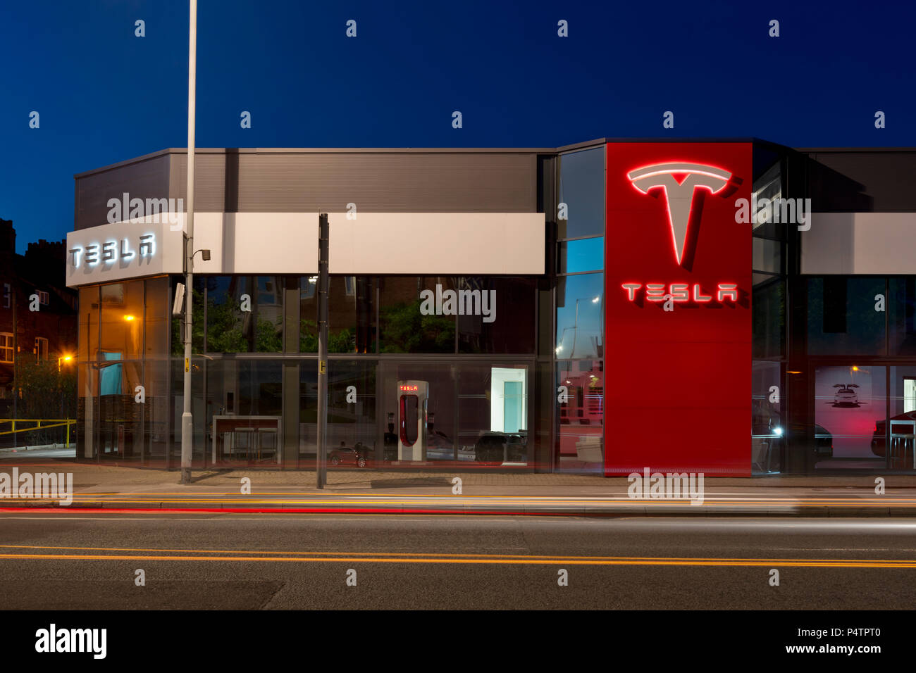 A Tesla showroom at night in South Manchester, UK. - Stock Image