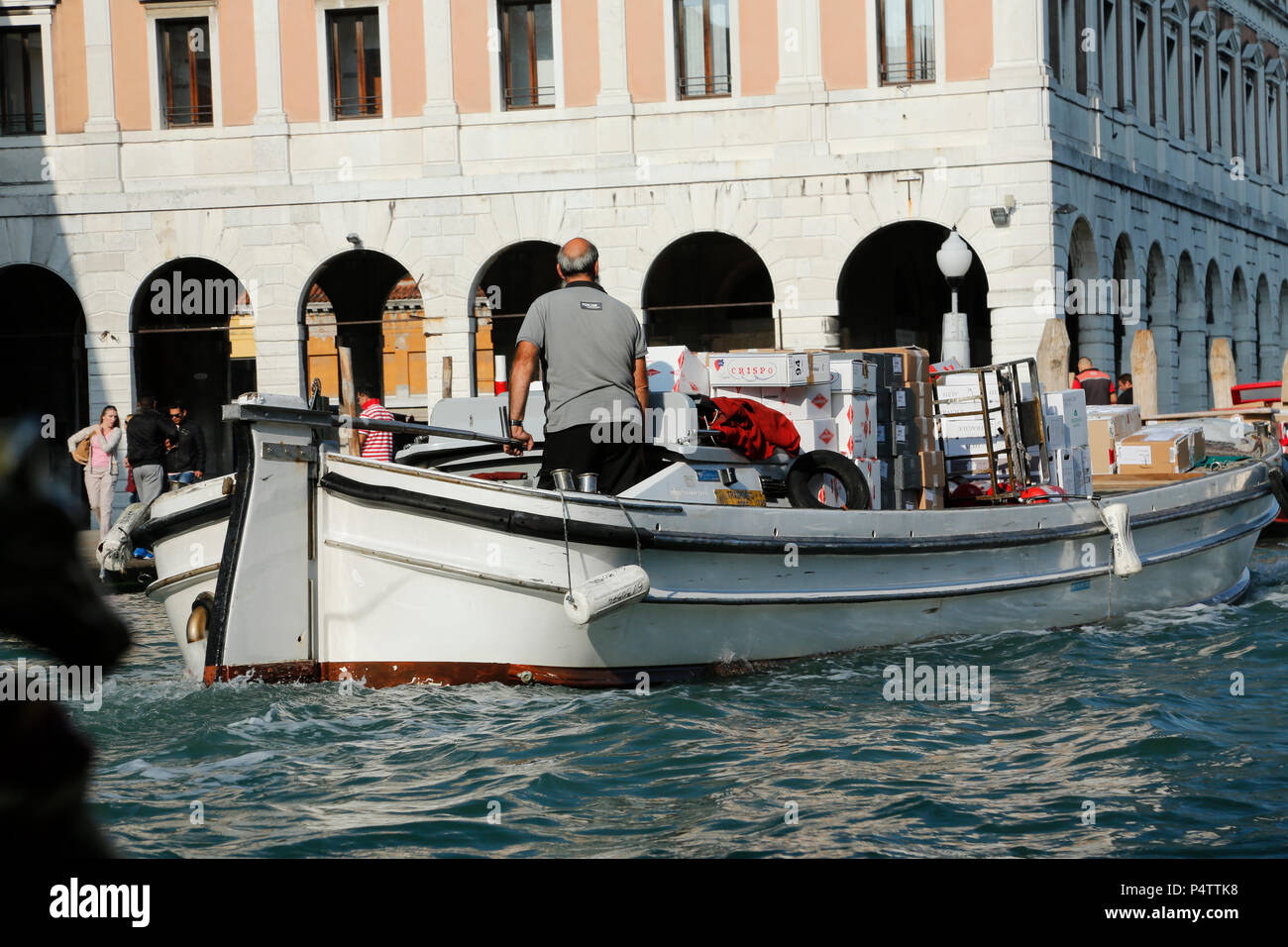 Morning delivery of products by boat on the Grand Canal, Venice, Italy. - Stock Image