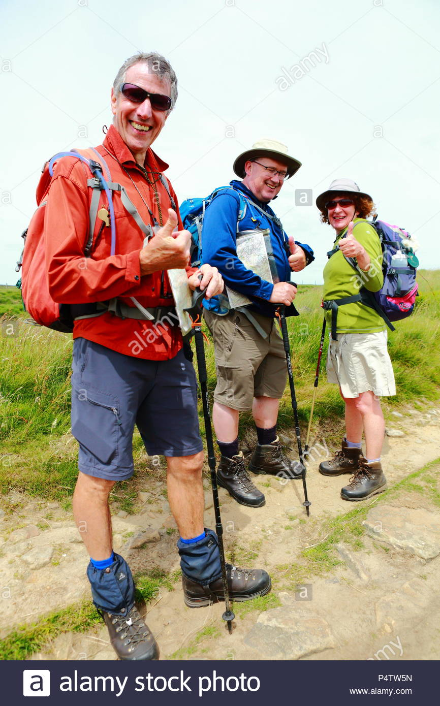 Ramblers & Walkers enjoying the open countryside of the Yorkshire & Lancashire moors along the Pennine Way at Standedge, Diggle, Oldham Summer 2018 - Stock Image