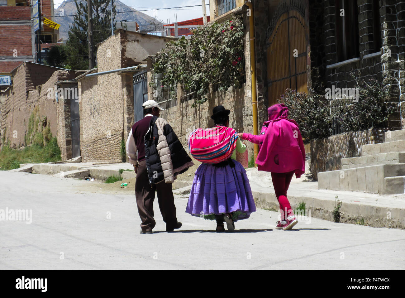 Bolivian family walking on the streets of Copacabana - Stock Image