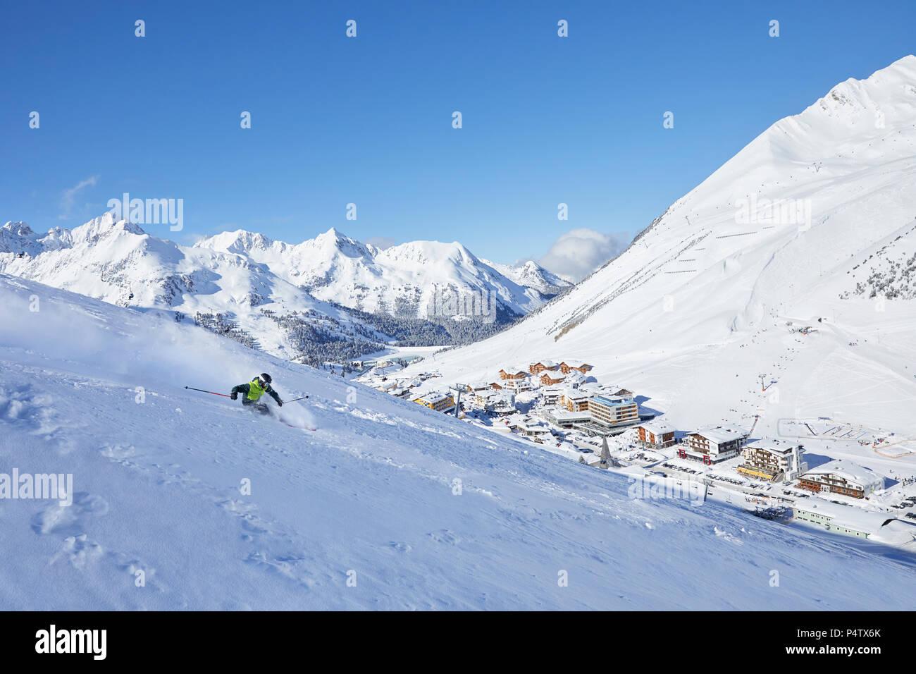 Austria, Tyrol, Kuehtai, man skiing in winter landscape - Stock Image