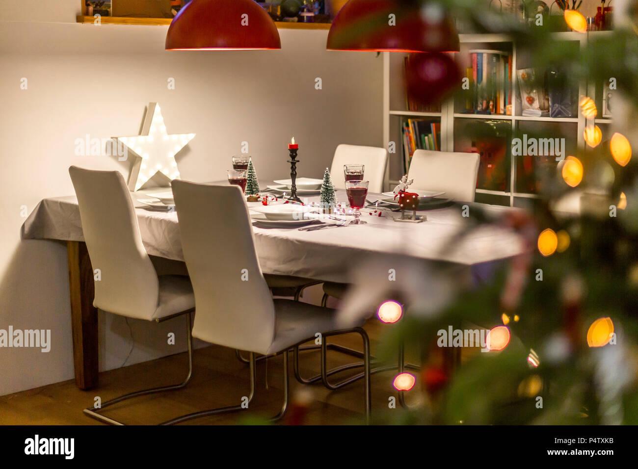 Laid table in dining room at Christmas time - Stock Image