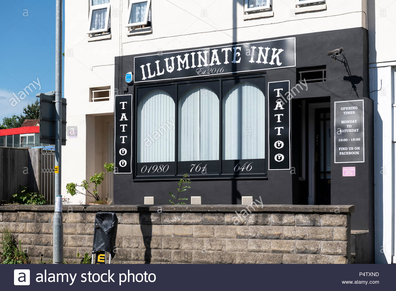 Illuminate Ink, The Centre, tattoo parlor, Amesbury, Wiltshire, England, UK - Stock Image