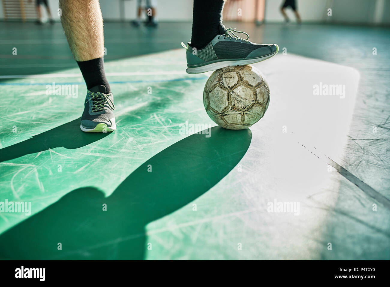 Close-up of indoor soccer player with ball - Stock Image