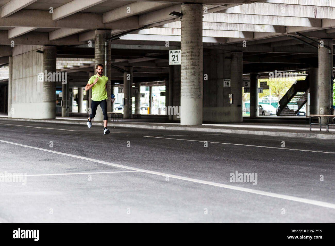Man running on a street - Stock Image