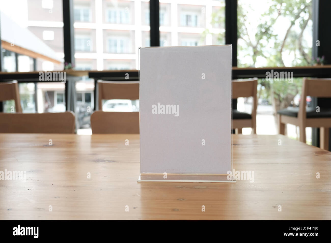 white label in cafe. display stand for acrylic tent card in coffee ...