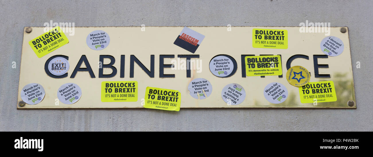 London, UK. 23 June 2018.Anti-Brexit march and rally for a People's Vote in Central London. Cabinet Office sign defaced with anti-Brexit stickers. - Stock Image