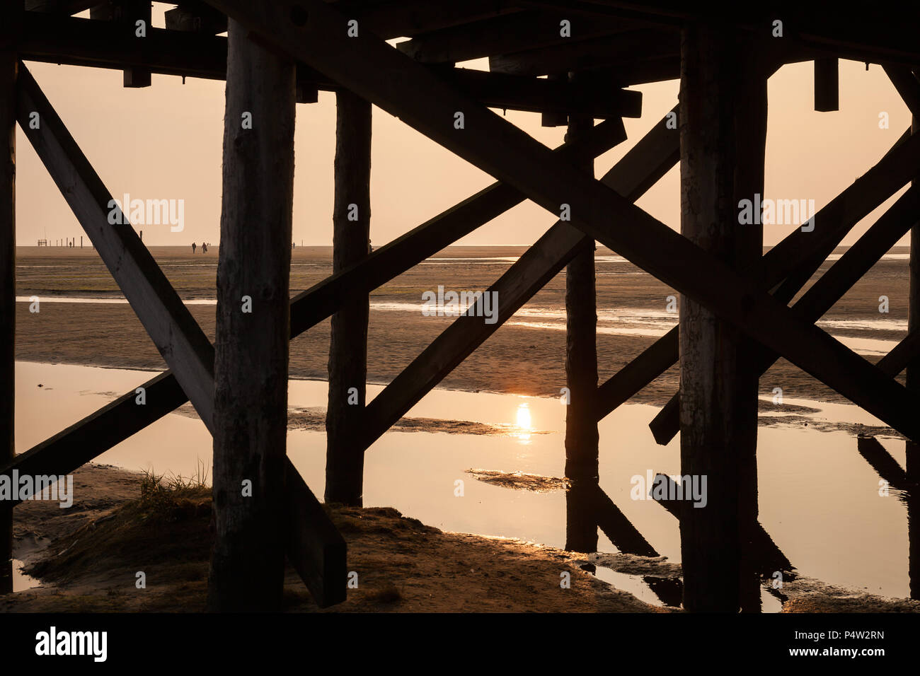 St. Peter Ording, Germany, substructure of a pile dwelling at low tide on the beach of St. Peter Ording - Stock Image