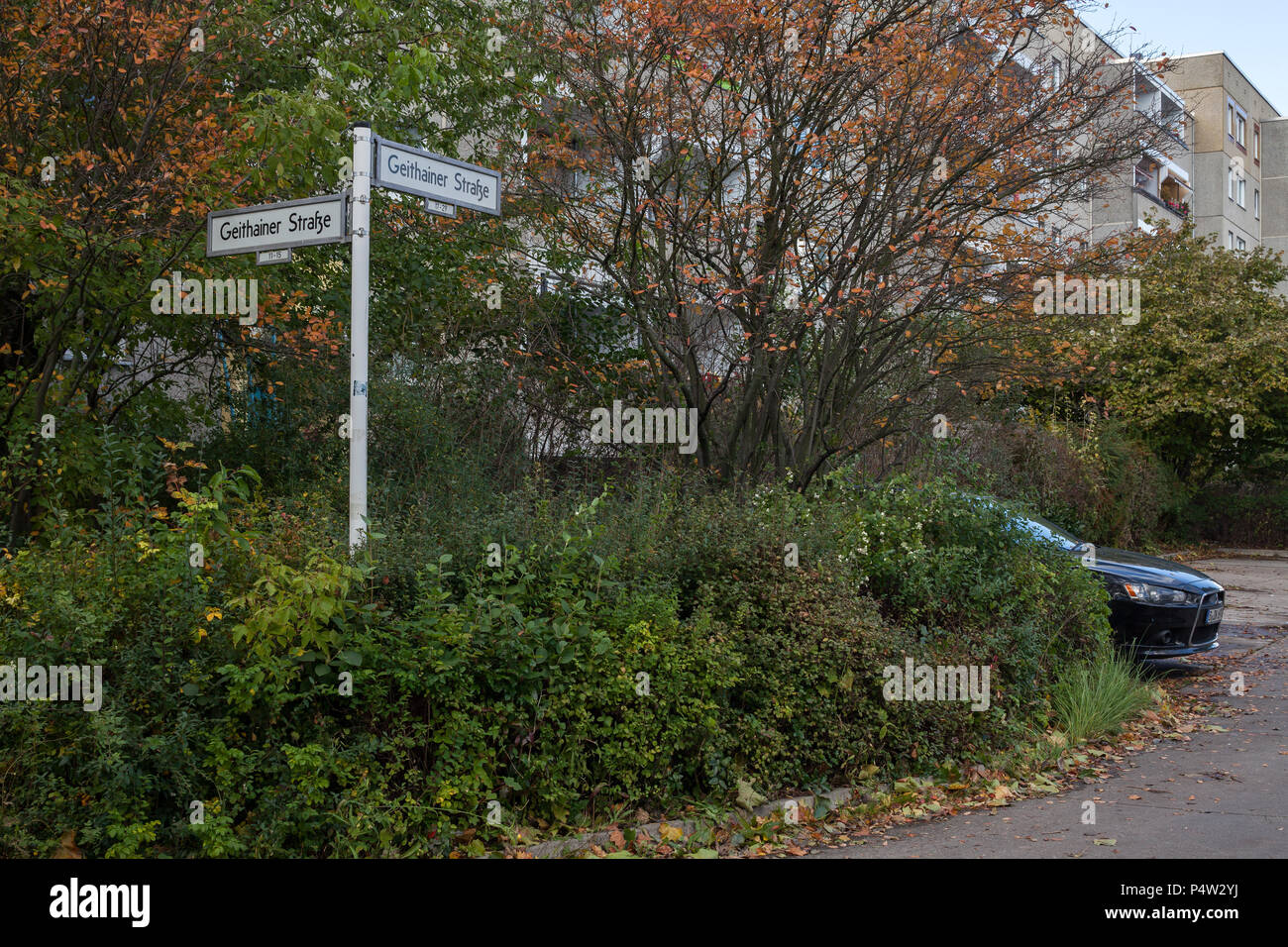 Berlin, Germany, street signs and parked car in Geithainer Strasse in Berlin-Hellersdorf - Stock Image