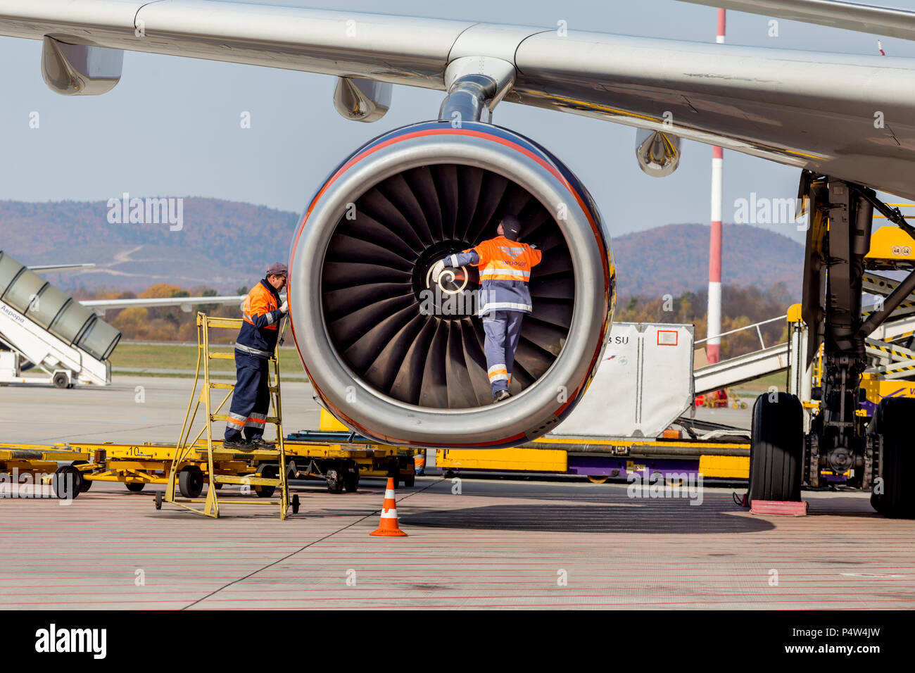 Russia, Vladivostok, 10/13/2017. Engineers check engine of jet aircraft after landing. Airbus A330 of Aeroflot Airlines. Aviation and equipment of air - Stock Image