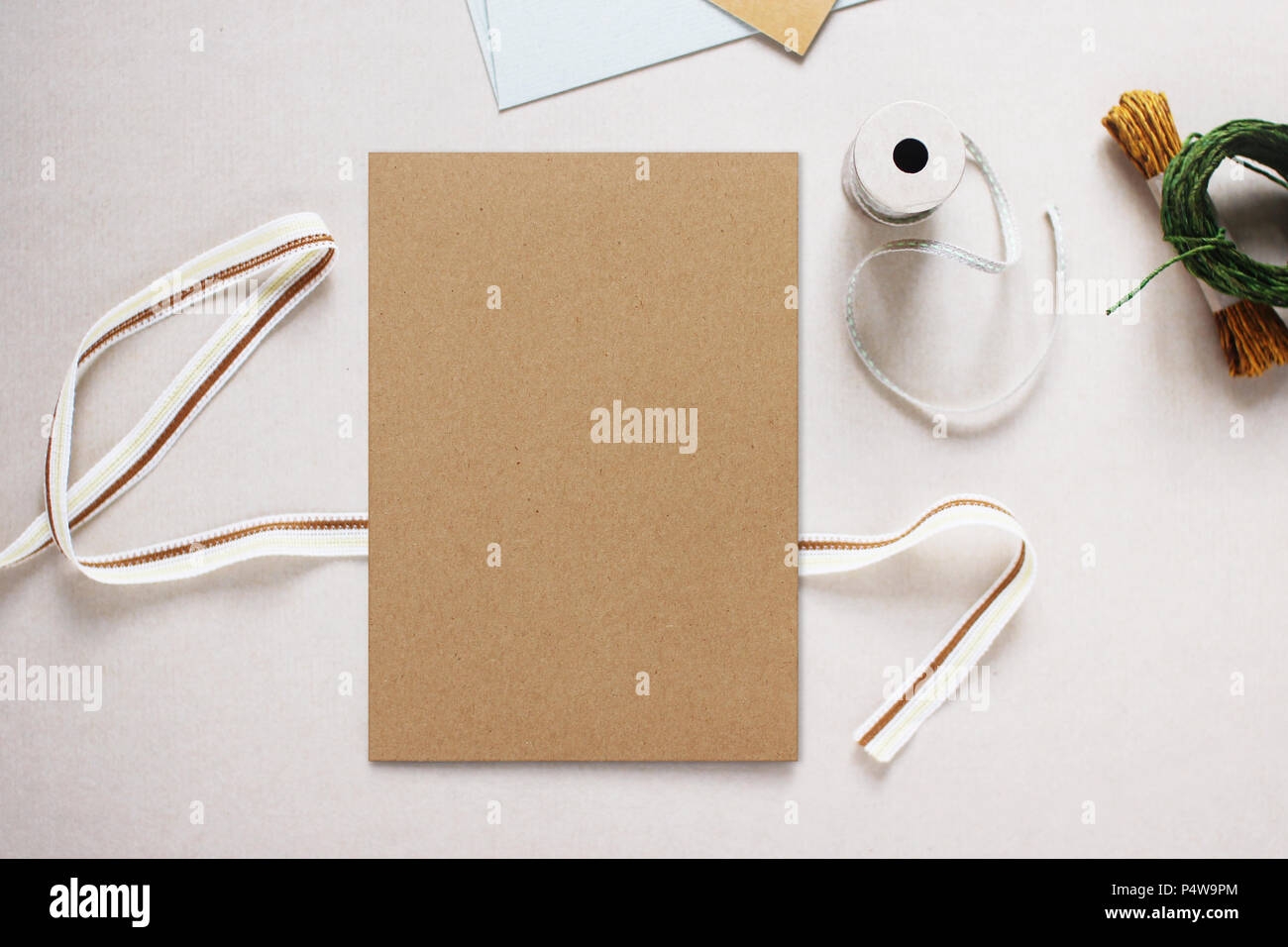 Mockup Image Of Brown Paper Invitation Card Surrounded By Craft