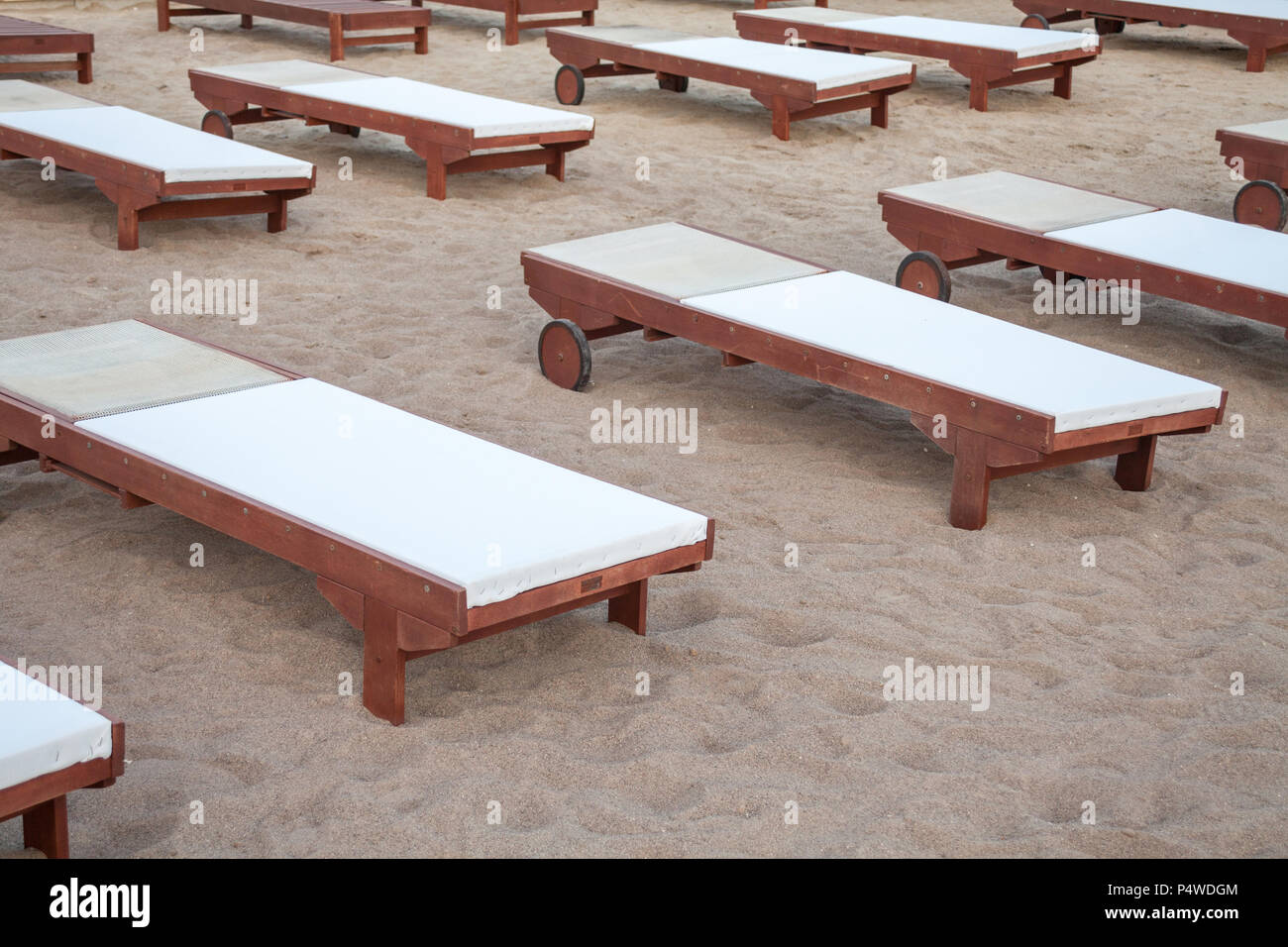 A relaxing beds fix in the sand. A flat structure filled with comfy fabric attracting tourist for body massage. Wellness therapy ideas for beach goers - Stock Image