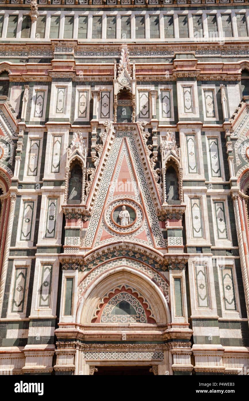 Ornate neo-gothic facade of the Cattedrale di Santa Maria del Fiore or Florence Cathedral (Il Duomo di Firenze), a famous UNESCO World Heritage Site a - Stock Image
