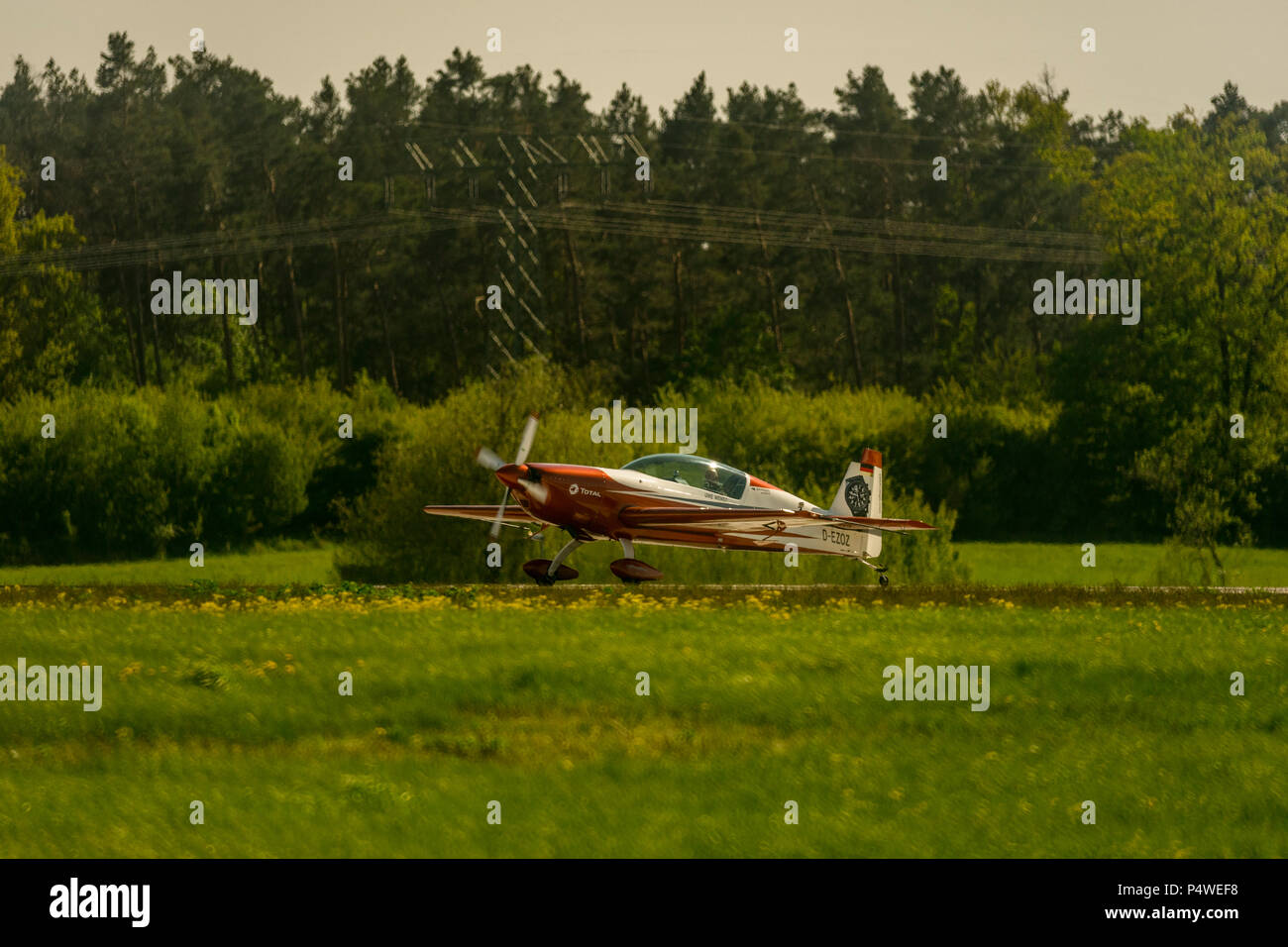 Uwe Wendt in his Extra 300L aeroplane on the runway of airport Schönefeld during the International Aerospace Exhibition ILA at airport Schoenefeld in  - Stock Image