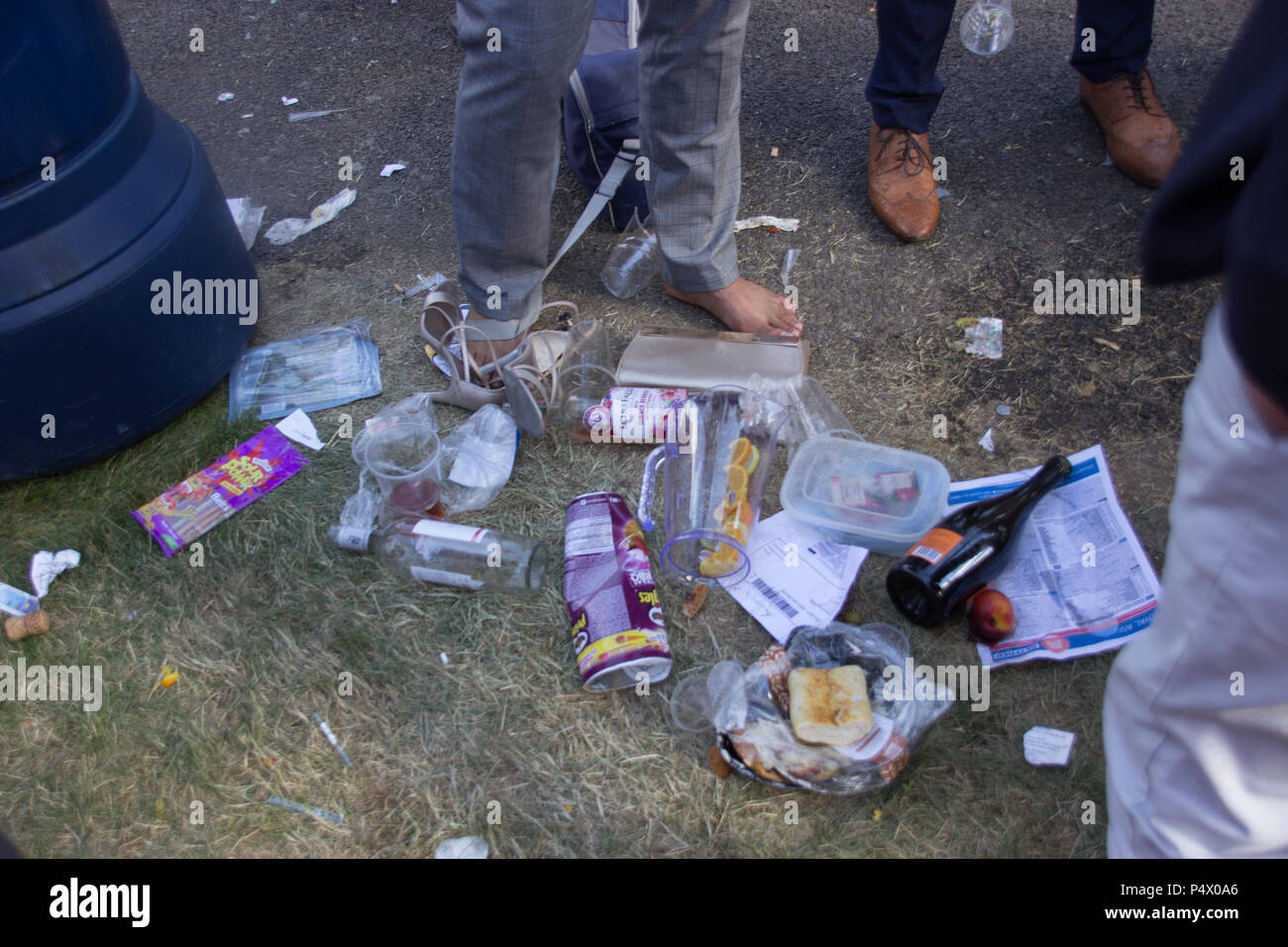 Assorted rubbish including cans and plastic cups thrown on ground and left during Ascot races - Stock Image