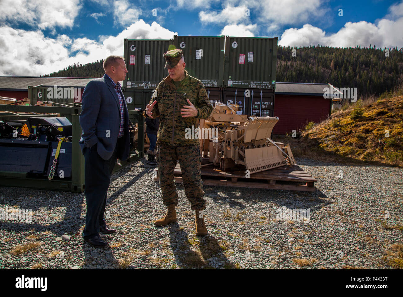 U.S. Marine Maj. Gen. Niel Nelson, commander of U.S. Marine Corps Forces Europe and Africa (MARFOREURAF), discusses the Marine Corps Prepositioning Program Norway (MCPP-N), with Lyle Layher, MARFOREURAF's prepositioning officer, at an assembly area in Norway, May 9, 2017. By storing equipment in Norwegian caves, MCPP-N eliminates the need to deploy equipment from the United States for contingency operations which decreases the time required to prepare units. Stock Photo