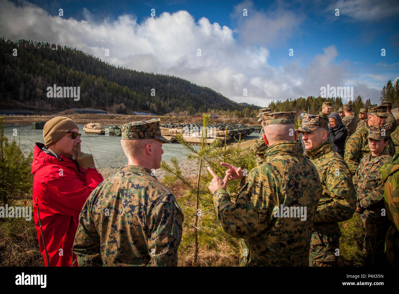 Lt. Gen. John Wissler, center, commander of U.S. Marine Corps Forces Command, speaks with Marines while overlooking an assembly area where Marine Corps Prepositioning Program Norway (MCPP-N) equipment is staged.  MCPP-N enables the rapid aggregation of a credible, agile, and flexible Marine Air Ground Task Force and creates operational and strategic options for the defense of NATO allies and partners. Stock Photo