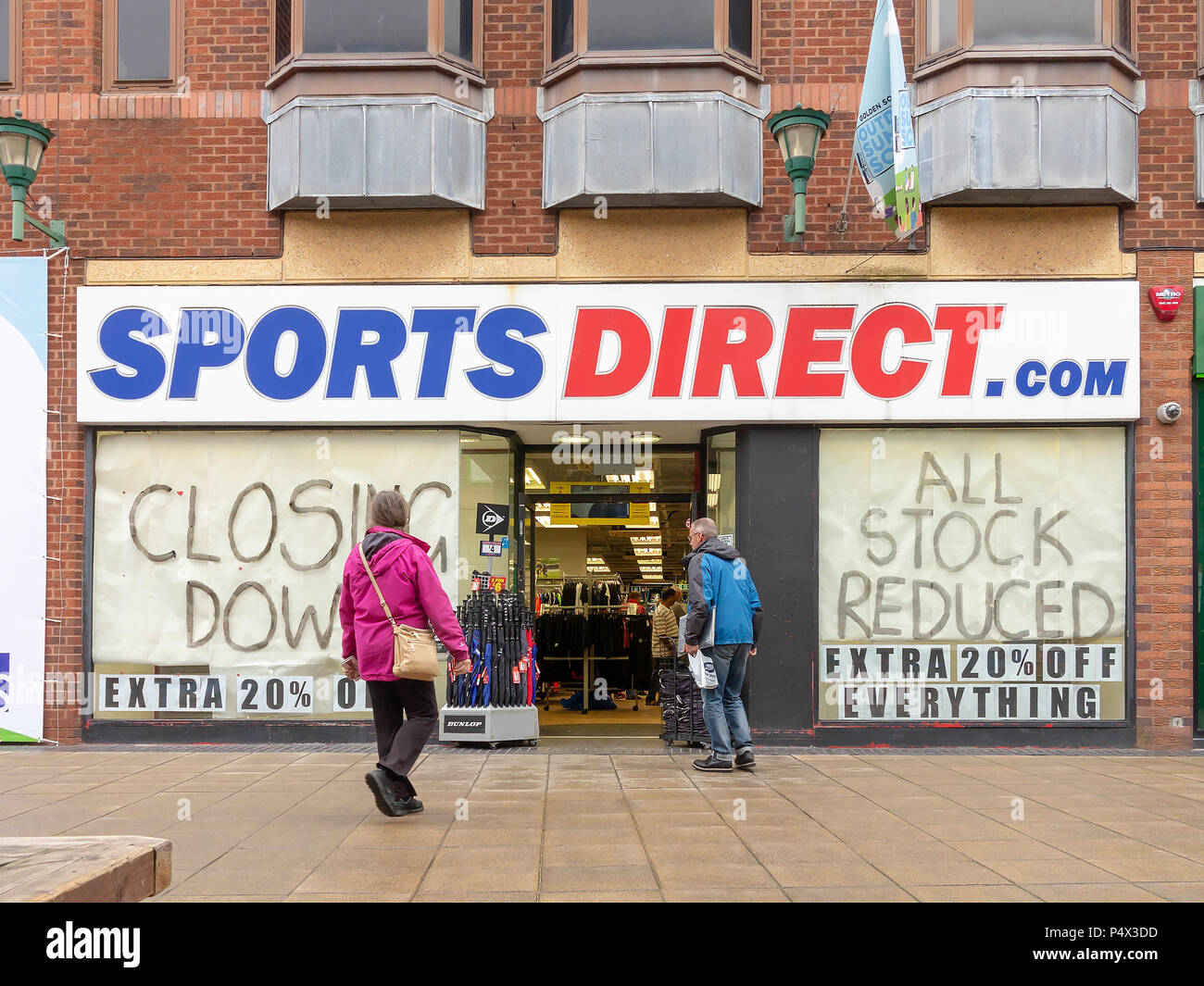 23 May 2018 - Closing Down signs in the windows of the Sports Direct shop in the Old Fishmarket area of Warrington Town Centre, next to The Golden Squ - Stock Image