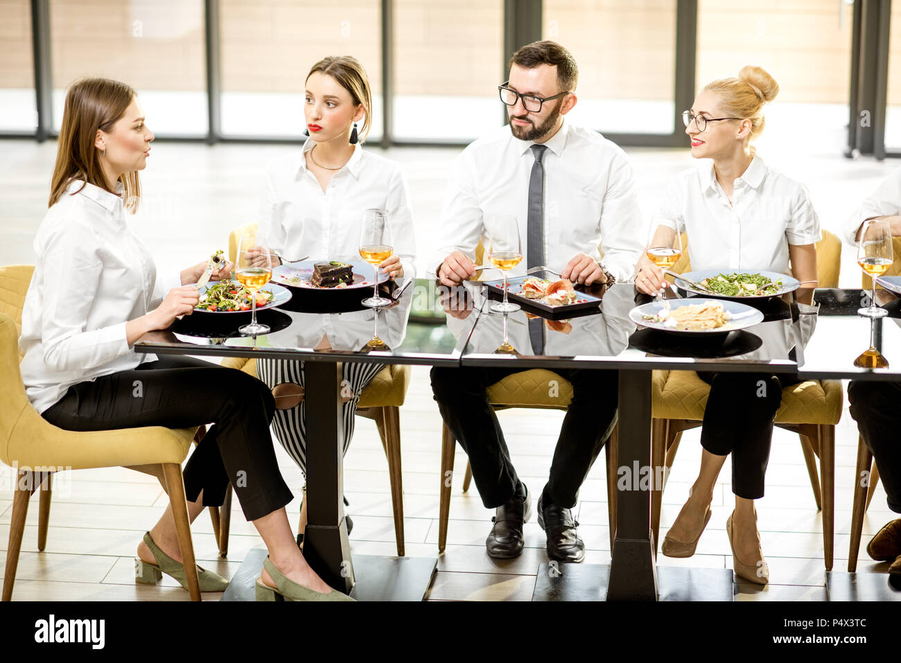 Business people during a lunch at the restaurant - Stock Image
