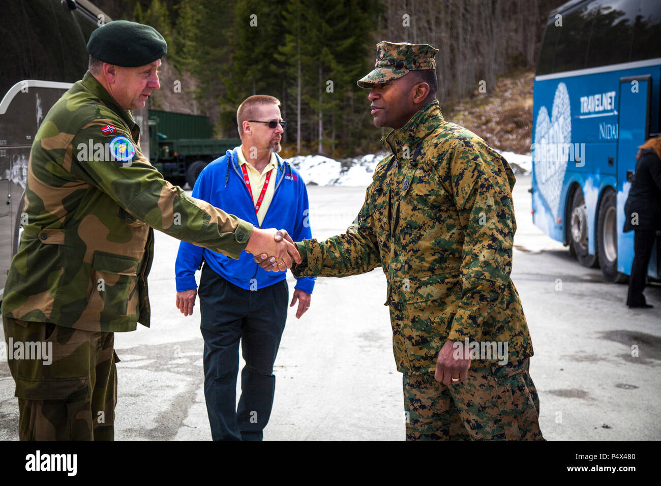 Capt. Ola Gilberg, Frigaard Cave Manager, left, and U.S. Marine Corps Sgt. Maj. Christopher Robinson, right, U.S. Marine Corps Forces Command Sergeant Major, shake hands after a tour of a cave site in Norway, May 9, 2017. The tour was given to senior Marines to show them the workings of Marine Corps Prepositioning Program Norway (MCPP-N). MCPP-N was created to support the rapid aggregation of a flexible Marine Air Ground Task Force. Stock Photo