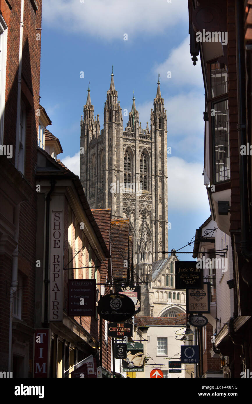 City of Canterbury, England. Shop fronts on Canterbury's Butchery Lane, with Canterbury Cathedral's Bell Harry Tower in the background. - Stock Image