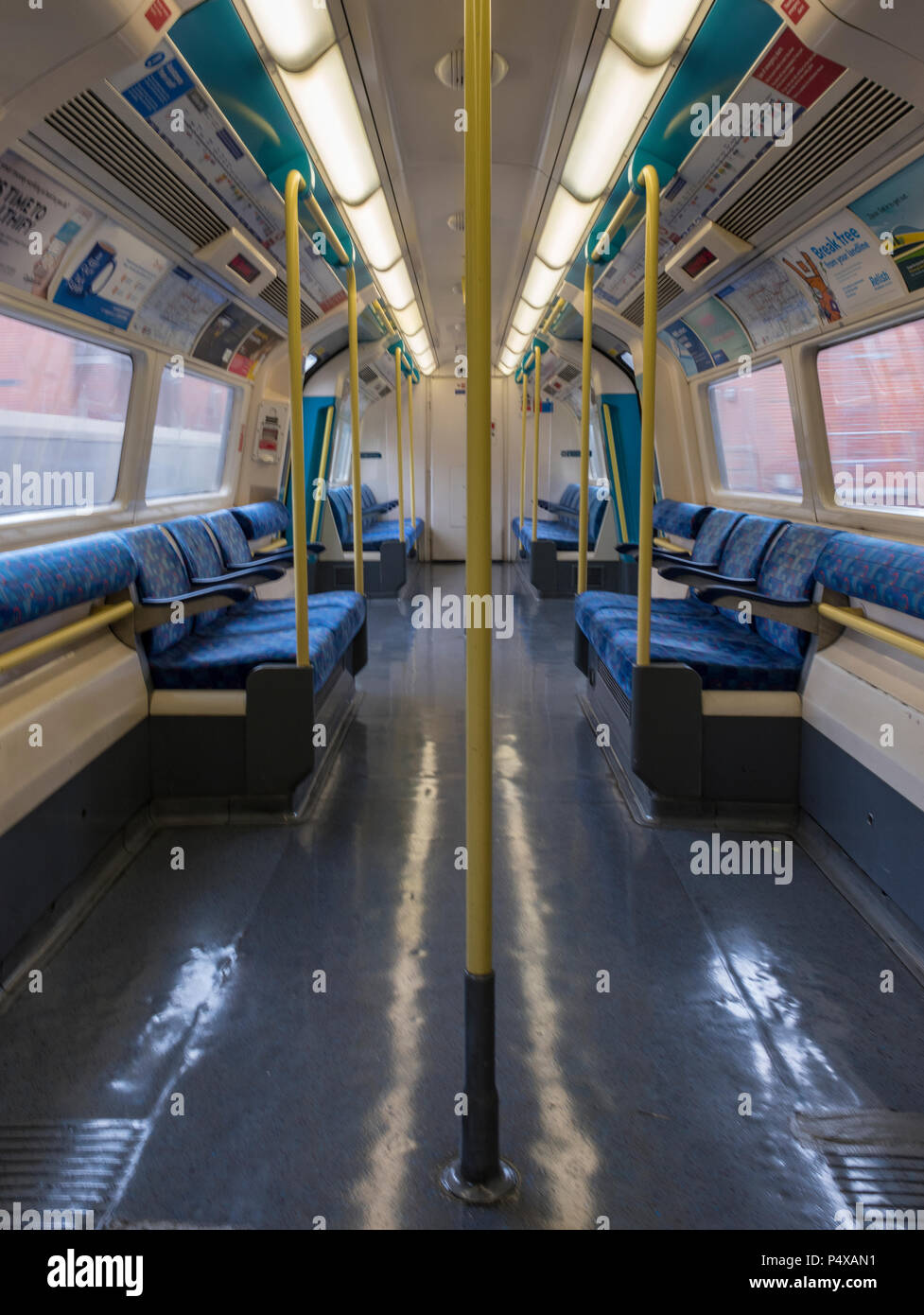 the inside of a london underground carriage on a tube train. - Stock Image