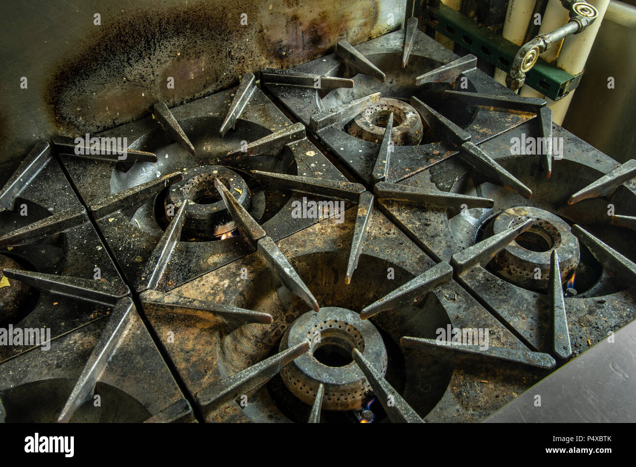 Commercial Stove Detail In Restaurant Kitchen - Stock Image