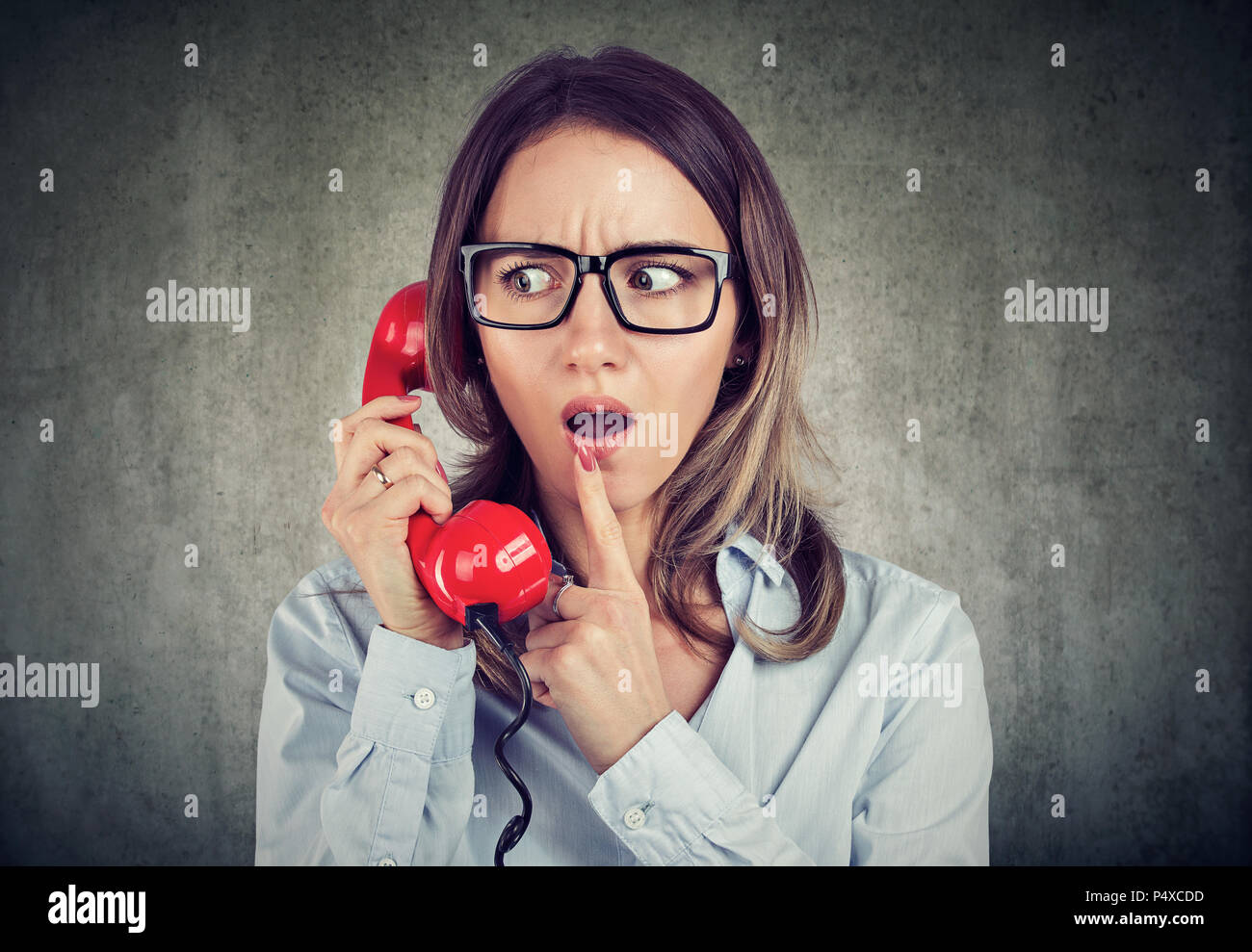 Worried young woman on the phone - Stock Image