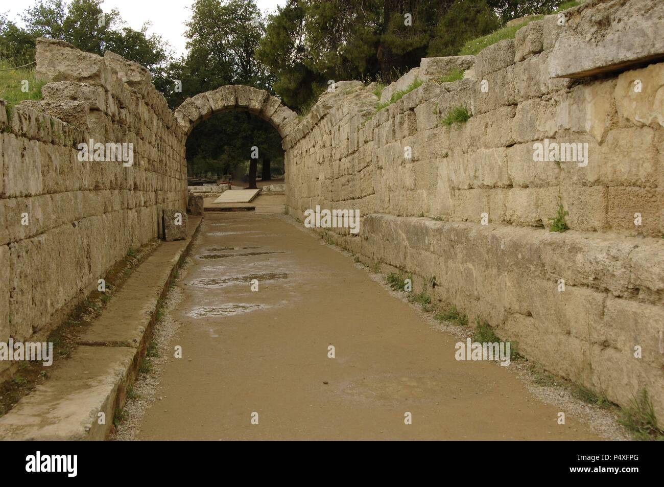 Greek Art. Sanctuary of Olympia. Olympic stadium.  The vaulted tunnel leading out of the stadium. Hellenistic period. Elis. Peloponesse. Greece. - Stock Image