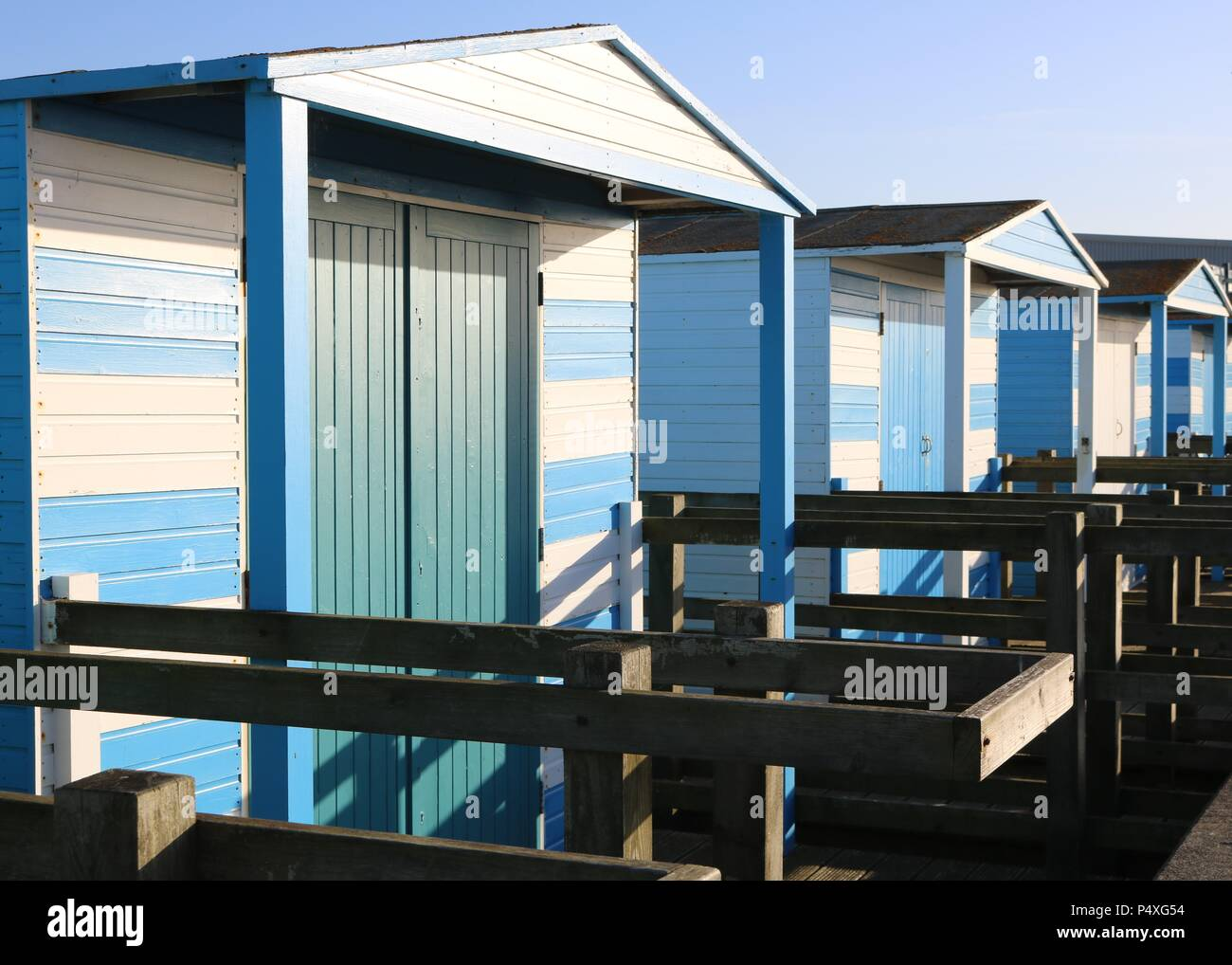 Blue beach huts at Whitstable , Kent - Stock Image