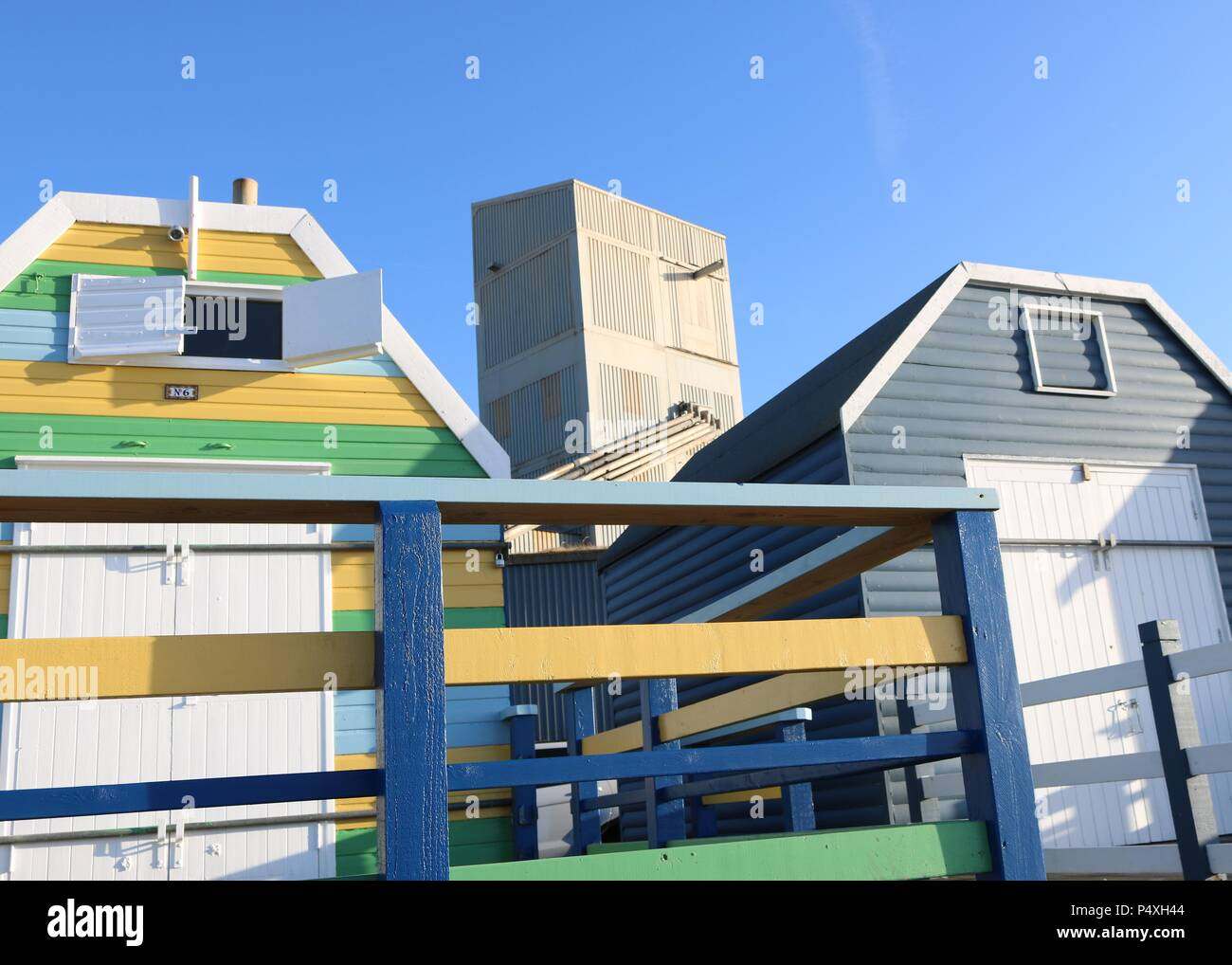 Beach huts & Factory Whitstable Kent - Stock Image