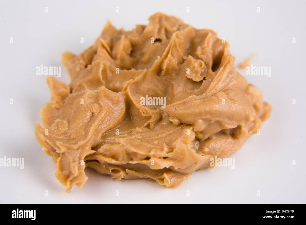 closeup of a peanut butter over white background. selective focus - Stock Image