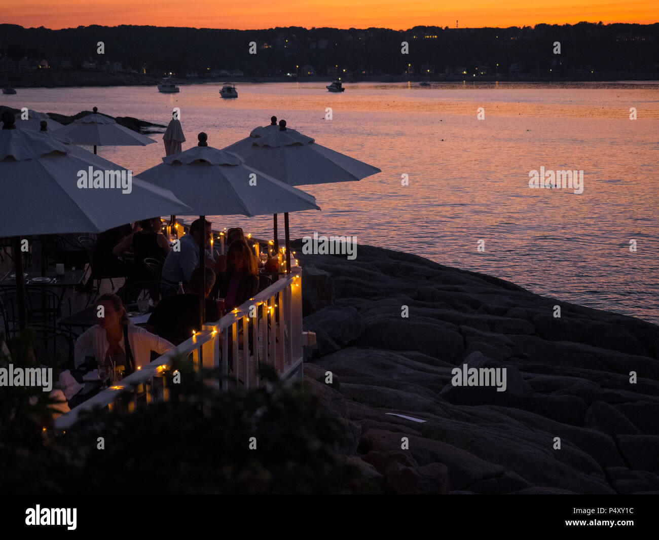 Sunset outdoor dining on the water at My Place by the Sea restaurant in Rockport, MA. - Stock Image