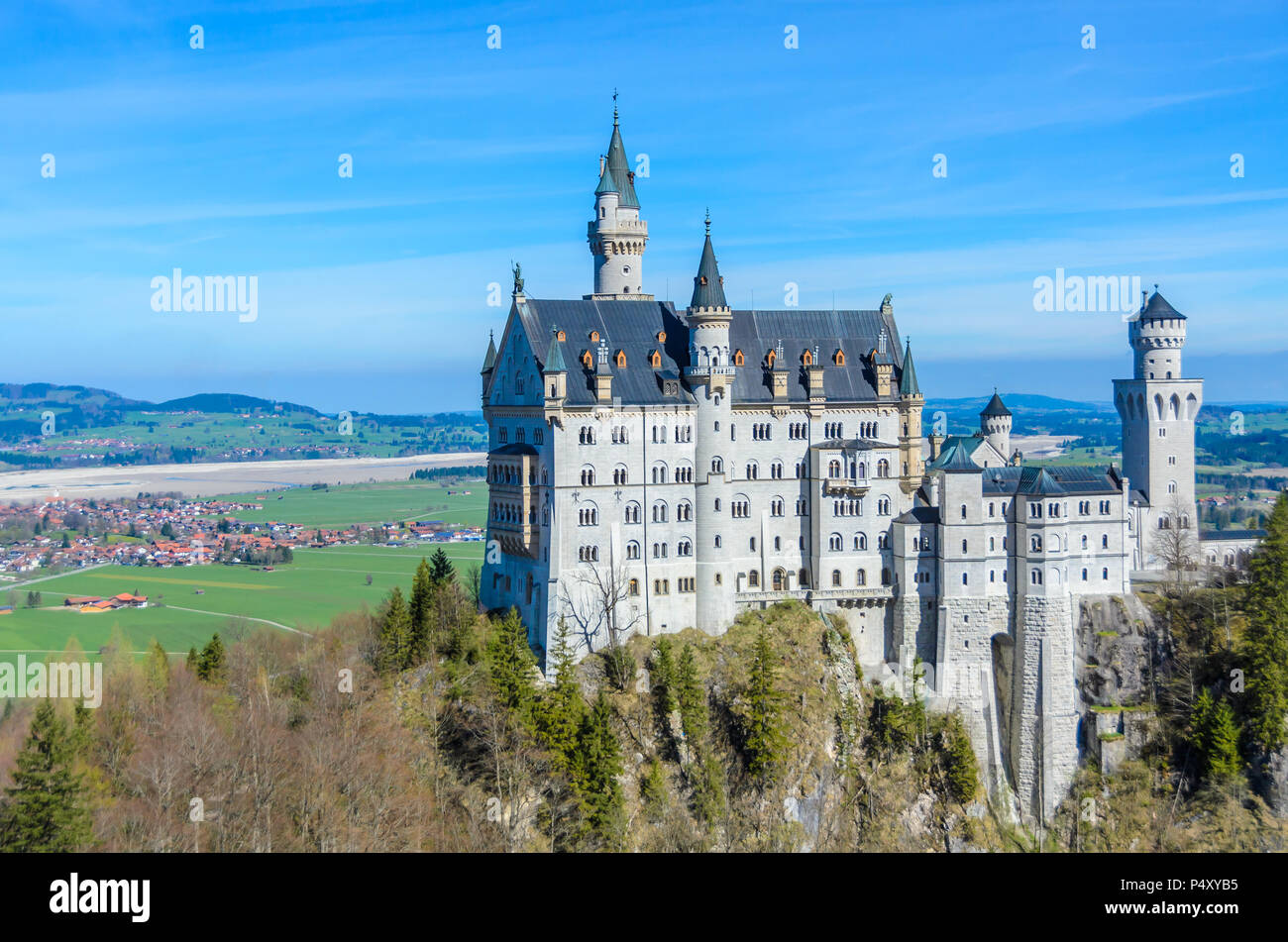 Neuschwanstein Castle, the nineteenth-century Romanesque Revival palace built for King Ludwig II on a rugged cliff near Fussen, Bavaria, Germany - Stock Image