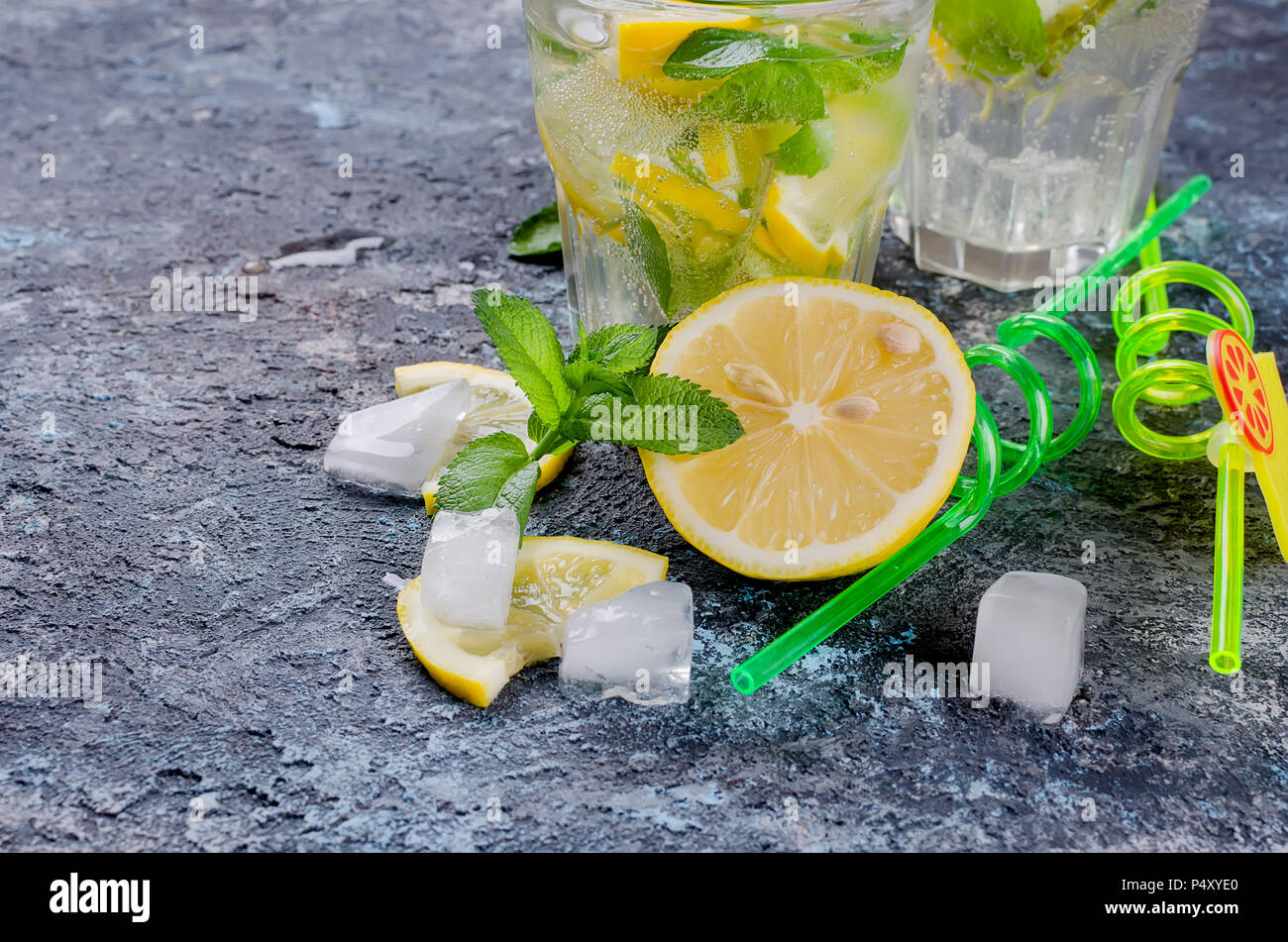 Lemon and mint,  ingredient for Cocktails mojito close up on dark bacground, copy spase, selective focus - Stock Image